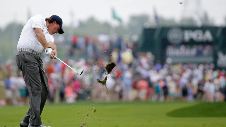 Phil Mickelson hits from the fairway on the first hole during the third round of the PGA Championship golf tournament at Valhalla Golf Club on Saturday, Aug. 9, 2014, in Louisville, Ky. (AP Photo/Jeff Roberson)