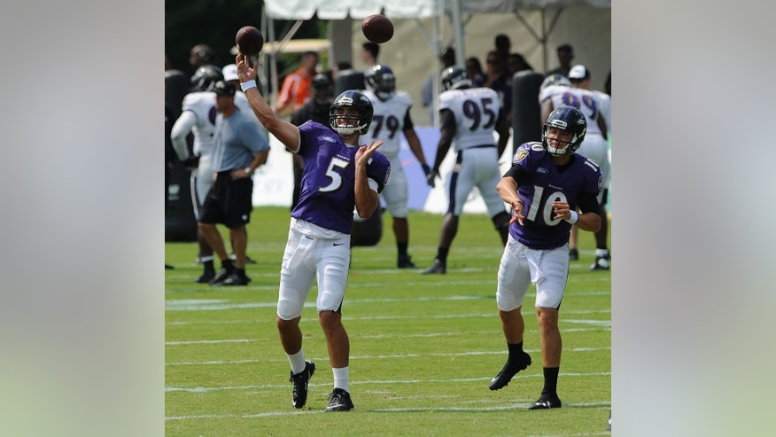 Baltimore Ravens quarterbacks, Joe Flacco, left and Keith Wenning throw in a joint football practice with the San Francisco 49ers, Saturday, Aug. 9, 2014, in Owings Mills, Md.(AP Photo/Gail Burton)