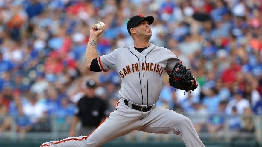 San Francisco Giants starting pitcher Tim Hudson throws in the first inning during a baseball game against the Kansas City Royals, Saturday, Aug. 9, 2014, in Kansas City, Mo. (AP Photo/Ed Zurga)