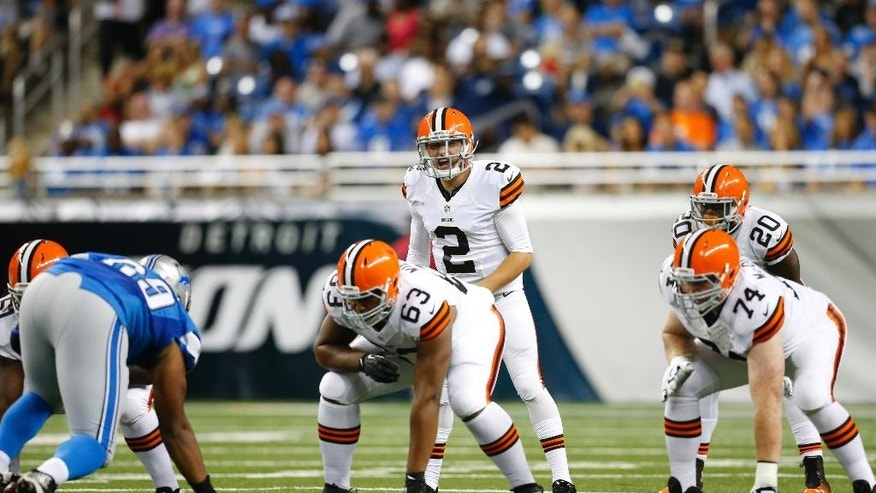 Cleveland Browns quarterback Johnny Manziel (2) lines up against the Detroit Lions in the first half of a preseason NFL football game at Ford Field in Detroit, Saturday, Aug. 9, 2014.  (AP Photo/Rick Osentoski)