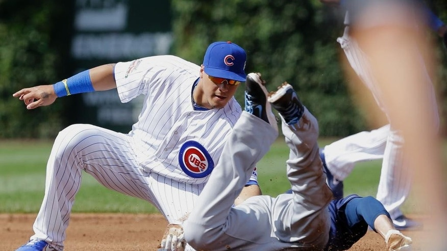 Chicago Cubs second baseman Javier Baez, left, tags out Tampa Bay Rays' Matt Joyce at second base during the second inning of an interleague baseball game in Chicago, Saturday, Aug. 9, 2014. (AP Photo/Nam Y. Huh)