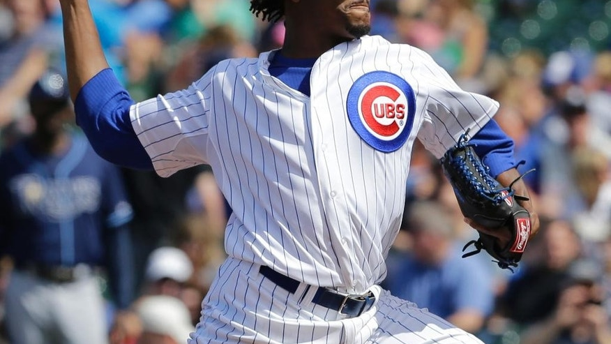 Chicago Cubs starter Edwin Jackson throws against the Tampa Bay Rays during the first inning of an interleague baseball game in Chicago, Saturday, Aug. 9, 2014. (AP Photo/Nam Y. Huh)