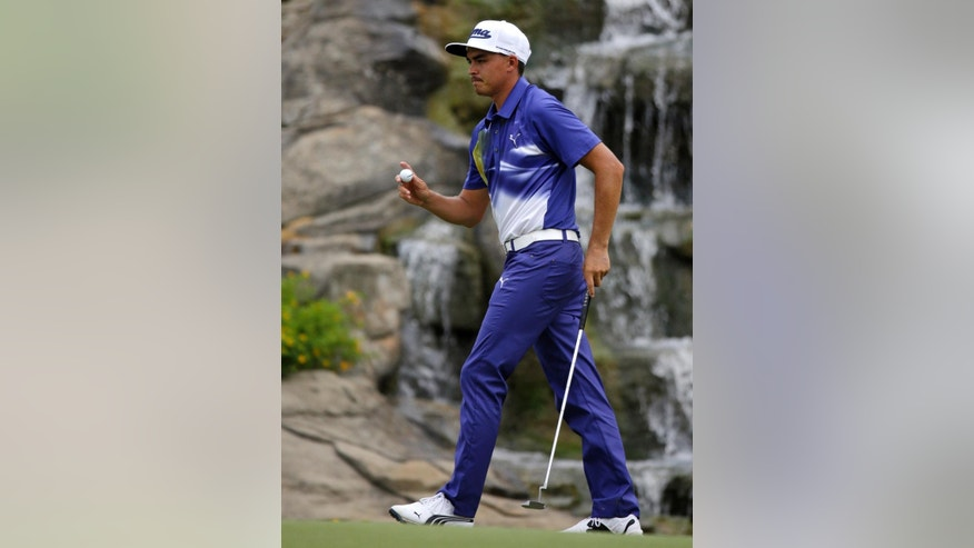 Rickie Fowler reacts after making a birdie on the 13th hole during the third round of the PGA Championship golf tournament at Valhalla Golf Club on Saturday, Aug. 9, 2014, in Louisville, Ky. (AP Photo/John Locher)
