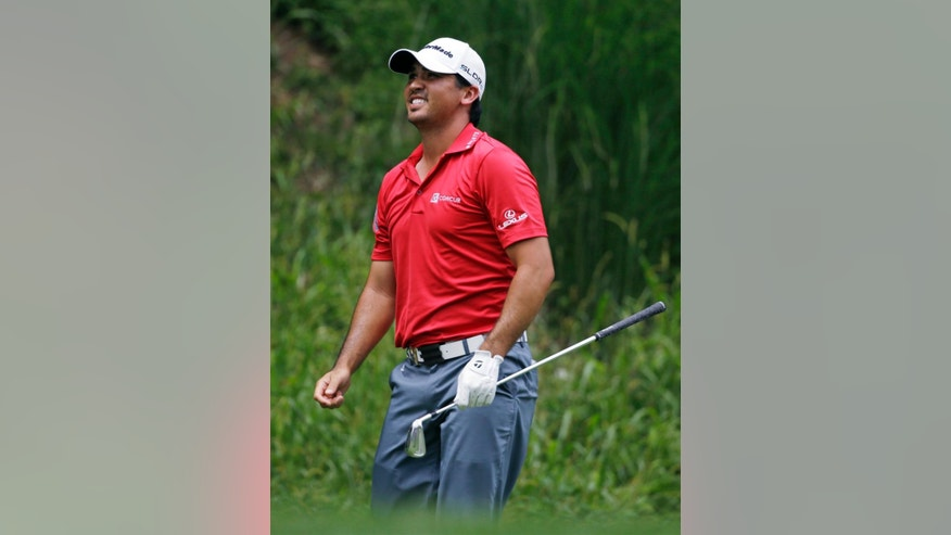Jason Day, of Australia, watches his tee shot on the third hole during the third round of the PGA Championship golf tournament at Valhalla Golf Club on Saturday, Aug. 9, 2014, in Louisville, Ky. (AP Photo/Jeff Roberson)