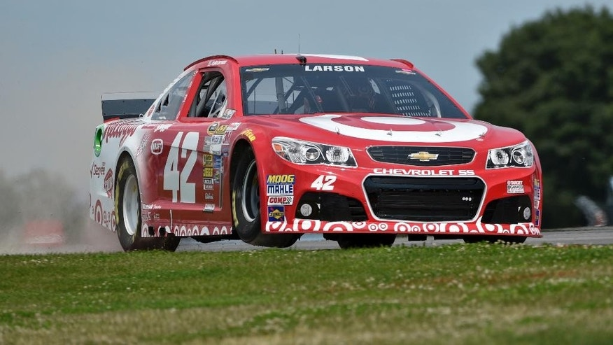 Kyle Larson (42) bumps a curb during a practice session for Sunday's NASCAR Sprint Cup Series auto race at Watkins Glen International, Friday, Aug. 8, 2014, in Watkins Glen N.Y. (AP Photo/Derik Hamilton)