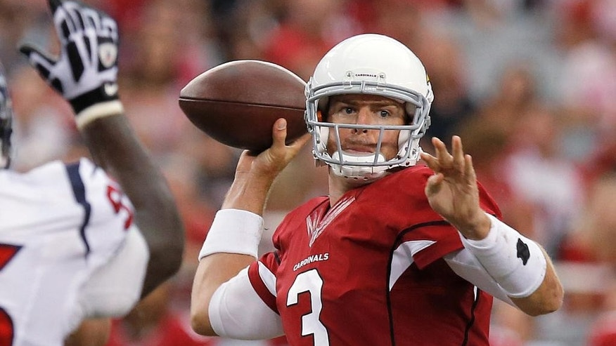 Arizona Cardinals quarterback Carson Palmer (3) throws against the Houston Texans during the first half of an NFL preseason football game, Saturday, Aug. 9, 2014, in Glendale, Ariz. (AP Photo/Ross D. Franklin)