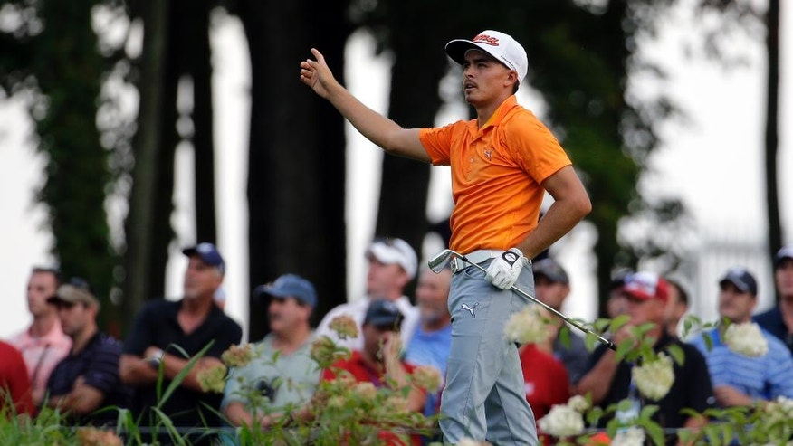 Rickie Fowler watches his tee shot on the 14th hole during the final round of the PGA Championship golf tournament at Valhalla Golf Club on Sunday, Aug. 10, 2014, in Louisville, Ky. (AP Photo/Jeff Roberson)