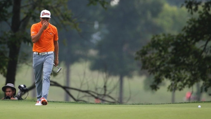 Rickie Fowler reacts after missing a birdie put on the 11th hole during the final round of the PGA Championship golf tournament at Valhalla Golf Club on Sunday, Aug. 10, 2014, in Louisville, Ky. (AP Photo/Jeff Roberson)