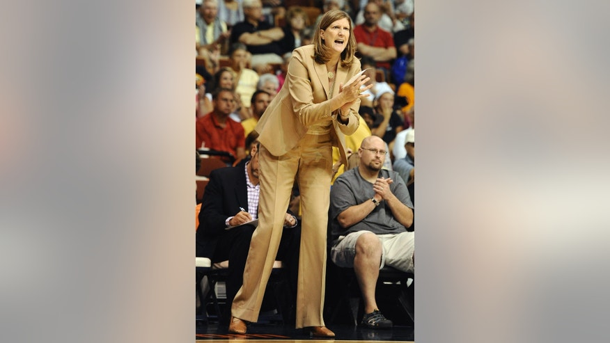 Connecticut Sun head coach Ann Donovan reacts during the second half of a WNBA basketball game against the Washington Mystics, Sunday, Aug. 10, 2014, in Uncasville, Conn. The Sun won in double overtime 89-81. (AP Photo/Jessica Hill)