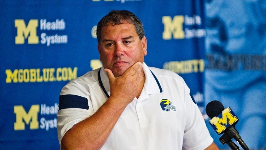 Michigan head coach Brady Hoke reacts as he answers questions at a news conference at the NCAA college football team's preseason media day, Sunday, Aug. 10, 2014, in Ann Arbor, Mich. (AP Photo/Tony Ding)