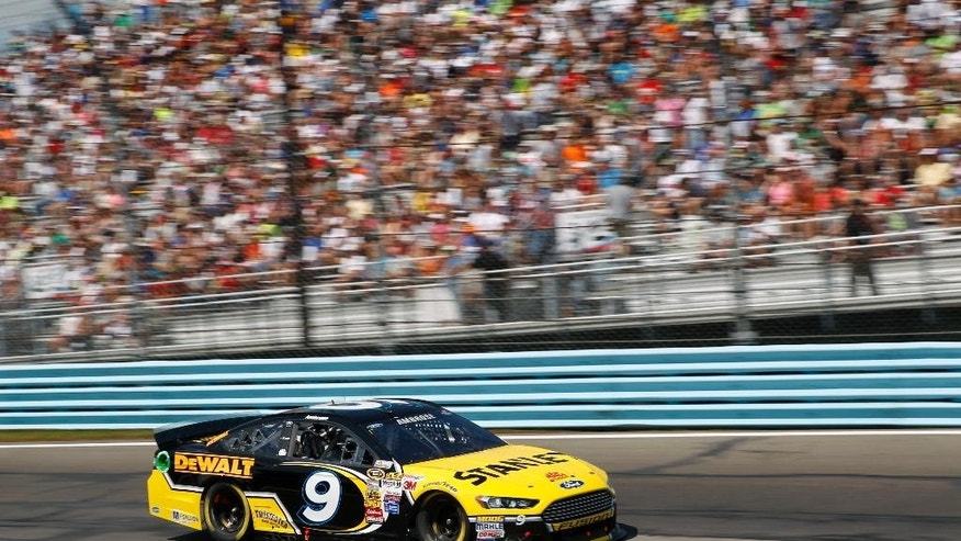 Marcos Ambrose (9) drives during a NASCAR Sprint Cup Series auto race at Watkins Glen International, Sunday, Aug. 10, 2014, in Watkins Glen N.Y. (AP Photo/Mel Evans)