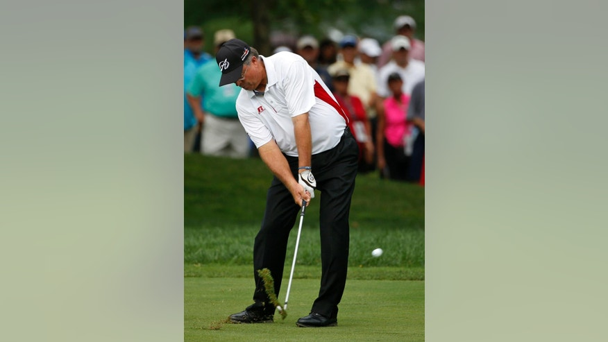Kenny Perry hits from the fairway on the first hole during the final round of the PGA Championship golf tournament at Valhalla Golf Club on Sunday, Aug. 10, 2014, in Louisville, Ky. (AP Photo/Mike Groll)