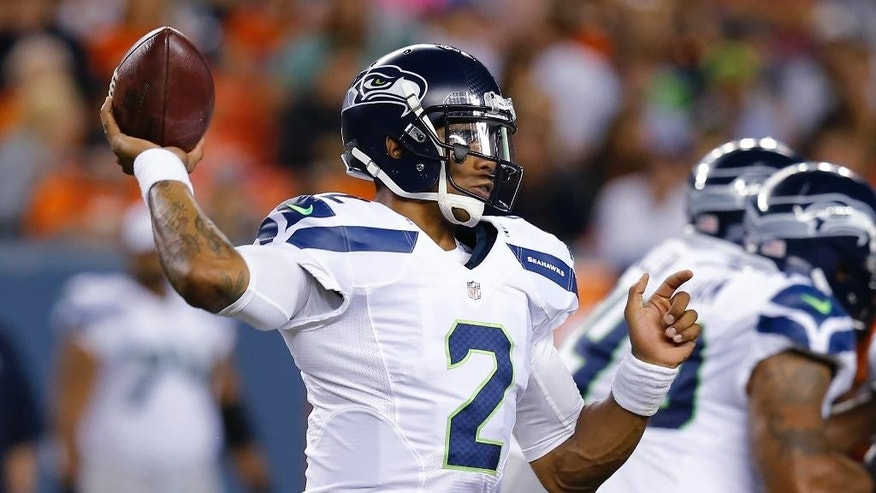 Seattle Seahawks quarterback Terrelle Pryor hrows against the Denver Broncos during the second half of an NFL preseason football game, Thursday, Aug. 7, 2014, in Denver. (AP Photo/Jack Dempsey)