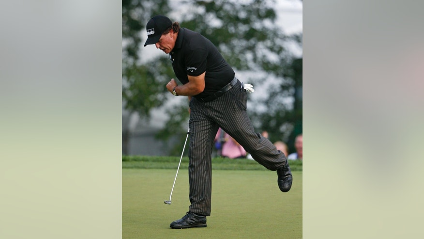 Phil Mickelson reacts after he saves par on the 12th hole during the final round of the PGA Championship golf tournament at Valhalla Golf Club on Sunday, Aug. 10, 2014, in Louisville, Ky. (AP Photo/Mike Groll)