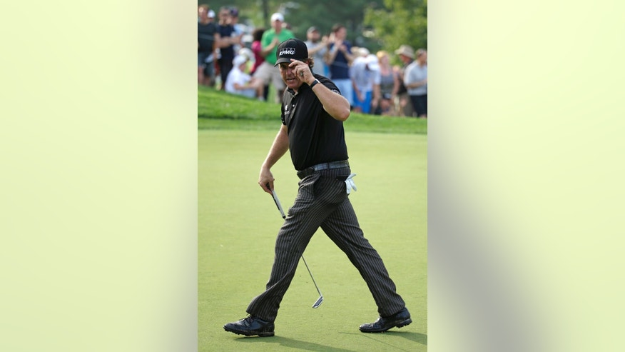 Phil Mickelson reacts after making a birdie on the ninth hole during the final round of the PGA Championship golf tournament at Valhalla Golf Club on Sunday, Aug. 10, 2014, in Louisville, Ky. (AP Photo/Jeff Roberson)