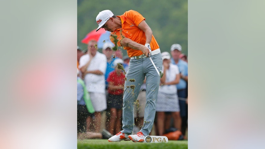 Rickie Fowler hits his tee shot on the eighth hole during the final round of the PGA Championship golf tournament at Valhalla Golf Club on Sunday, Aug. 10, 2014, in Louisville, Ky. (AP Photo/Mike Groll)