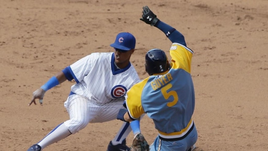 Tampa Bay Rays' Brandon Guyer, right, steals second base as Chicago Cubs shortstop Starlin Castro waits for the ball during the seventh inning of an interleague baseball game in Chicago, Sunday, Aug. 10, 2014. (AP Photo/Nam Y. Huh)