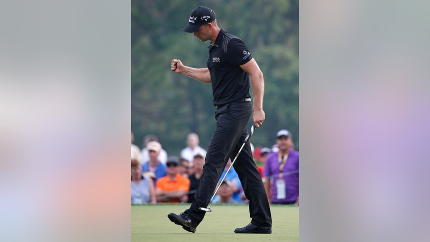 Henrik Stenson, of Sweden, celebrates a par on the 12th hole during the final round of the PGA Championship golf tournament at Valhalla Golf Club on Sunday, Aug. 10, 2014, in Louisville, Ky. (AP Photo/Mike Groll)