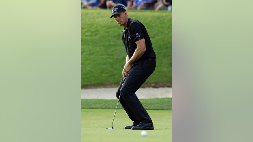 Henrik Stenson, of Sweden, watches his putt on the 14th hole during the final round of the PGA Championship golf tournament at Valhalla Golf Club on Sunday, Aug. 10, 2014, in Louisville, Ky. (AP Photo/John Locher)