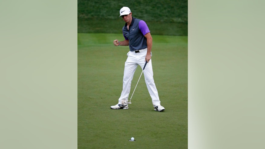 Rory McIlroy, of Northern Ireland, celebrates a birdie on the 17th hole during the final round of the PGA Championship golf tournament at Valhalla Golf Club on Sunday, Aug. 10, 2014, in Louisville, Ky. (AP Photo/Jeff Roberson)