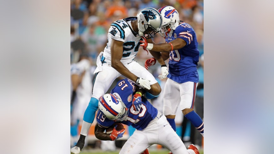 Buffalo Bills' Mike Williams (19) is tackled by Carolina Panthers' Josh Norman (24) as Bills' Robert Woods (10) arrives during the first half of a preseason NFL football game in Charlotte, N.C., Friday, Aug. 8, 2014. (AP Photo/Bob Leverone)