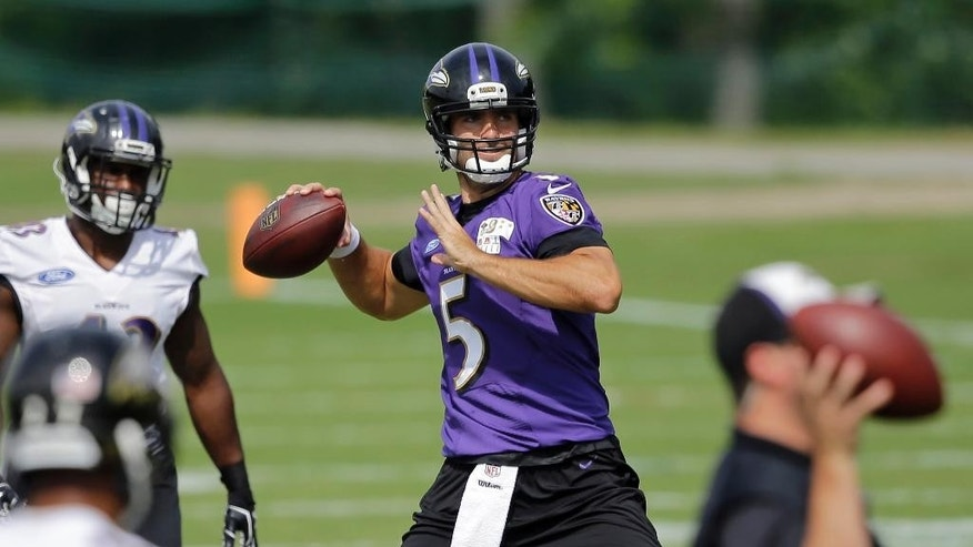 Baltimore Ravens quarterback Joe Flacco throws to a receiver during an NFL football training camp practice, Monday, Aug. 11, 2014, in Owings Mills, Md. (AP Photo/Patrick Semansky)