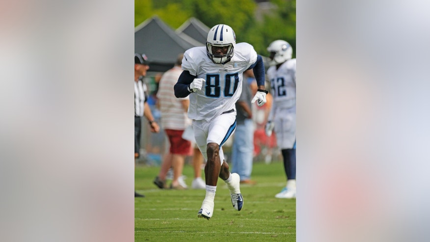 FILE - In this Aug. 1, 2014, file photo, Tennessee Titans wide receiver Derek Hagan runs a play during NFL football training camp in Nashville, Tenn. Hagan sat around all last season hoping for a phone call from an NFL team. Now he's in training camp with the Titans hoping to earn a roster spot keeping him around the league for another season. (AP Photo/Mark Humphrey, File)
