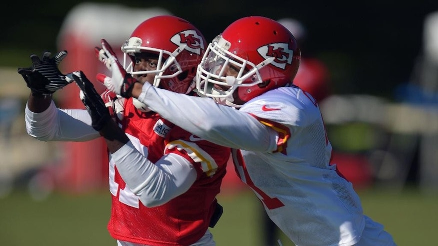 Kansas City Chiefs cornerback Marcus Cooper, right, defends Donnie Avery (17) during NFL football training camp Tuesday morning, Aug. 12, 2014, in St. Joseph. Mo. (AP Photo/St. Joseph News-Press, Todd Weddle)