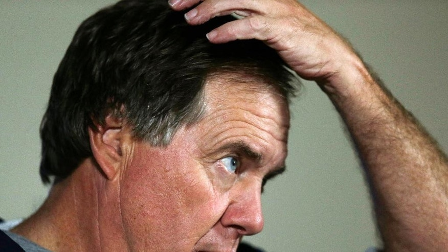 New England Patriots head coach Bill Belichick holds his head as he answers a reporter's question before an NFL Football training camp scrimmage of New England Patriots and Philadelphia Eagles in Foxborough, Mass., Tuesday, Aug. 12, 2014. (AP Photo/Charles Krupa)