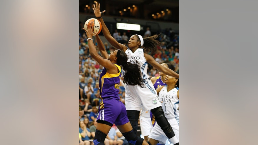 Los Angeles Sparks guard Candice Wiggins, left, pushes up to the basket against Minnesota Lynx forward Devereaux Peters in the first half of a WNBA basketball game, Tuesday, Aug. 12, 2014, in Minneapolis. (AP Photo/Stacy Bengs)