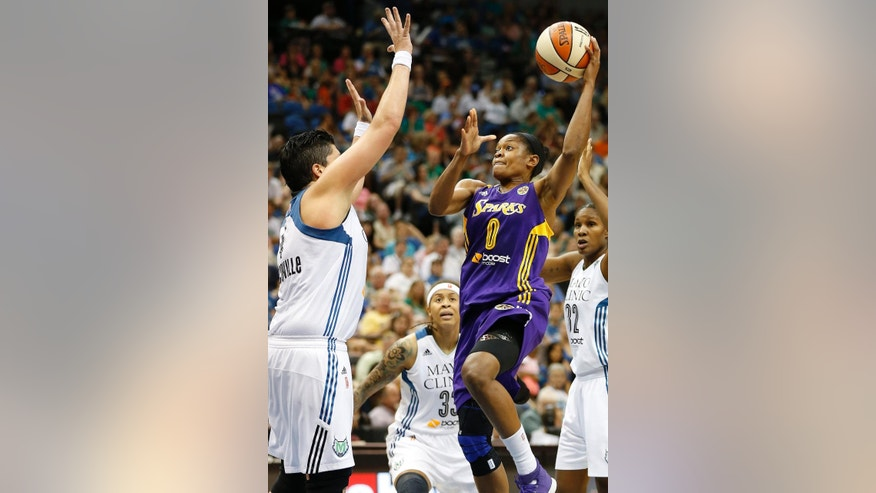 Los Angeles Sparks guard Alana Beard (0) shoots the ball against Minnesota Lynx center Janel McCarville (4) in the first half of a WNBA basketball game, Tuesday, Aug. 12, 2014, in Minneapolis. (AP Photo/Stacy Bengs)