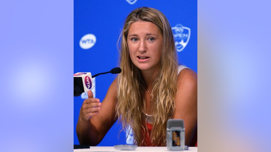 Victoria Azarenka, from Belarus, answers questions during a news conference at the Western & Southern Open tennis tournament, Sunday, Aug. 10, 2014, in Mason, Ohio. Azarenka is the defending champion at the event. (AP Photo/Al Behrman)