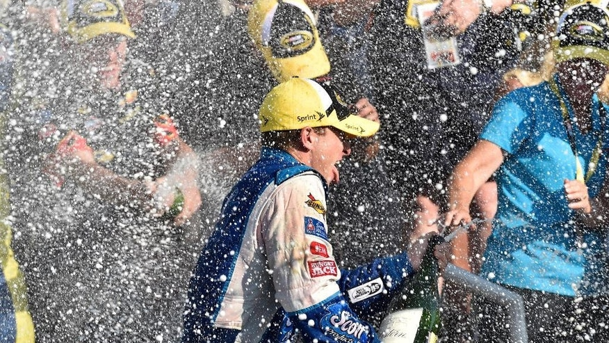 AJ Allmendinger, center, celebrates in Victory Lane after winning a NASCAR Sprint Cup Series auto race at Watkins Glen International, Sunday, Aug. 10, 2014, in Watkins Glen, N.Y. (AP Photo/Derik Hamilton)