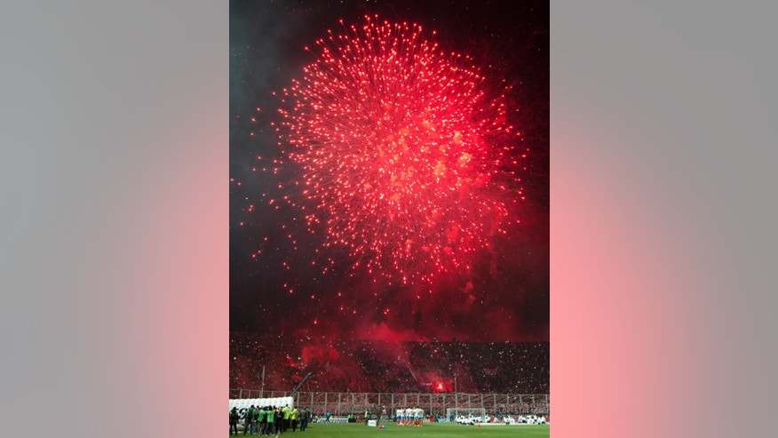 Fireworks explode at the start of a Copa Libertadores final soccer match between Argentina's San Lorenzo and Paraguay's Nacional in Buenos Aires, Argentina, Wednesday, Aug. 13, 2014. (AP Photo/Victor R. Caivano)