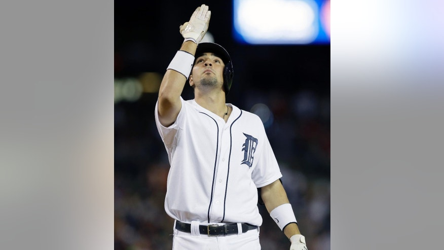 Detroit Tigers' Nick Castellanos looks skyward as he crosses home plate after his solo home run during the sixth inning of an interleague baseball game against the Pittsburgh Pirates, Wednesday, Aug. 13, 2014 in Detroit. (AP Photo/Carlos Osorio)