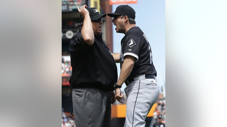 Chicago White Sox manager Robin Ventura, right, is ejected by umpire Fieldin Culbreth for arguing a call on San Francisco Giants' Gregor Blanco, who was originally ruled out at home but then ruled safe after review, during the seventh inning of a baseball game in San Francisco, Wednesday, Aug. 13, 2014. (AP Photo/Jeff Chiu)