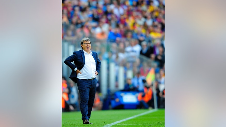 FILE - In this May 17, 2014, file photo, FC Barcelona's coach Gerardo Martino, from Argentina, looks on during a Spanish La Liga soccer match between FC Barcelona and Atletico Madrid at the Camp Nou stadium in Barcelona, Spain. The Argentine Football Association announced Tuesday August 12, 2014, that is has named Martino as the Argentina National Soccer Team head coach.  (AP Photo/Manu Fernandez, File)
