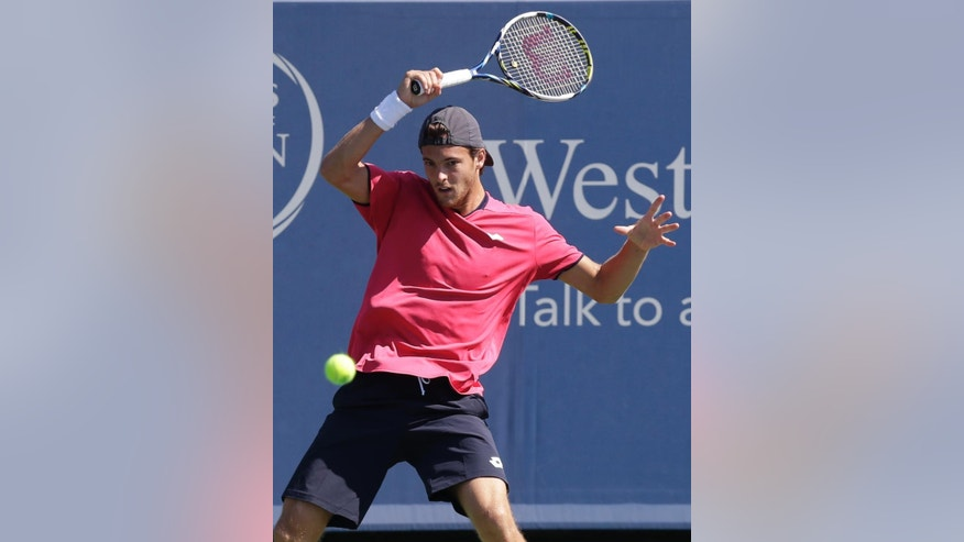 Joao Sousa, from Portugal, hits a forehand against Andy Murray, from Great Britain, during a match at the Western & Southern Open tennis tournament, Wednesday, Aug. 13, 2014, in Mason, Ohio. Murray won 6-3, 6-3. (AP Photo/Al Behrman)