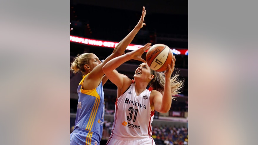 Chicago Sky guard/forward Elena Delle Donne (11) guards Washington Mystics center Stefanie Dolson (31) during the second half of a WNBA basketball game Wednesday, Aug. 13, 2014 in Washington.  The Sky won 72-69. (AP Photo/Alex Brandon)