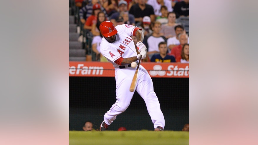Los Angeles Angels' Howie Kendrick hits an RBI single during the sixth inning of a baseball game against the Philadelphia Phillies, Wednesday, Aug. 13, 2014, in Anaheim, Calif. (AP Photo/Mark J. Terrill)