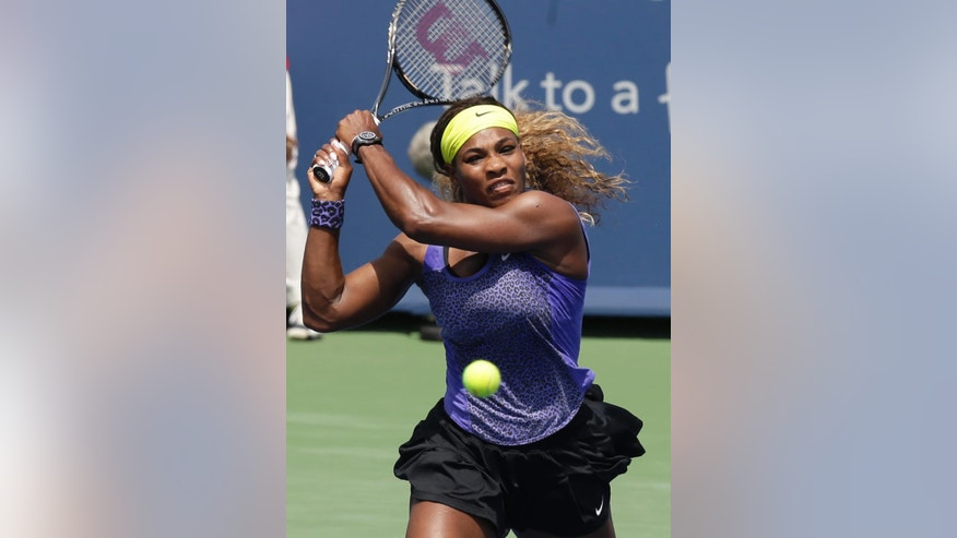 Serena Williams volleys against Flavia Pennetta, from Italy, during a match at the Western & Southern Open tennis tournament, Thursday, Aug. 14, 2014, in Mason, Ohio. (AP Photo/Al Behrman)