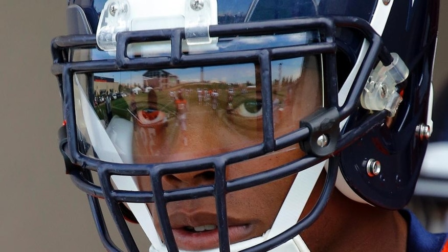 Denver Broncos' Brandon Marshall is focused as he takes to the practice field during NFL football training camp on Thursday, Aug. 14, 2014, in Englewood, Colo. (AP Photo/Jack Dempsey)