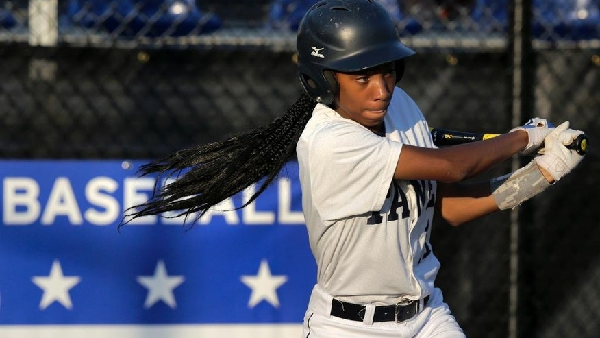 FILE - In this Aug. 6, 2014, file photo, Pennsylvania's Mo'ne Davis follows through on a single against the District of Columbia during a baseball game in the Little League Eastern Regionals at Breen Stadium in Bristol, Conn. Two girls will be competing at the same time for just the third time in the Little League World Series' 68-year history. But unlike many of the 16 girls that have preceded them, there's a future for Philadelphia's Mo'ne Davis and Canada's Emma March to pitch beyond the fields of Williamsport, Pennsylvania.(AP Photo/Charles Krupa, File)
