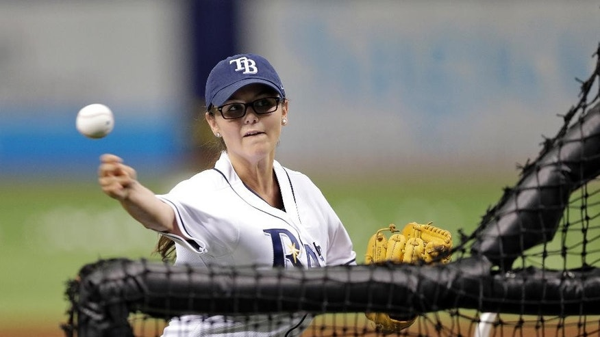 FILE - In this June 23, 2014, file photo, Chelsea Baker, a junior knuckleball pitcher on the Durant, Fla., High School boys baseball team, throws batting practice to members of the Tampa Bay Rays before an interleague baseball game against the Pittsburgh Pirates in St. Petersburg, Fla. Baker said she has received interest from colleges, but no offers yet. (AP Photo/Chris O'Meara, File)