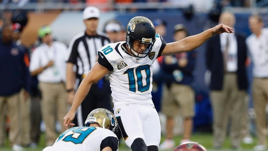 Jacksonville Jaguars kicker Josh Scobee (10) kicks a 25-yard field goal against the Chicago Bears during the first half of an NFL preseason football game in Chicago, Thursday, Aug. 14, 2014. (AP Photo/Charles Rex Arbogast)