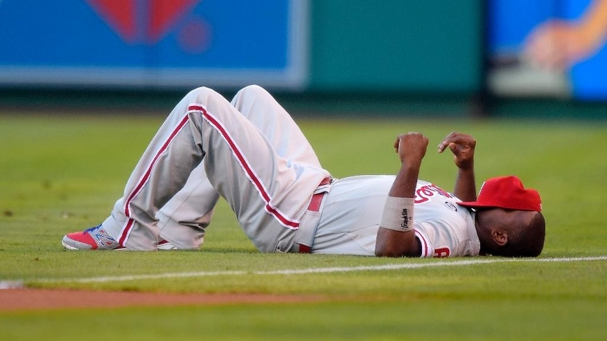 Philadelphia Phillies' Ryan Howard lays on the field prior to their baseball game against the Los Angeles Angels, Wednesday, Aug. 13, 2014, in Anaheim, Calif. (AP Photo/Mark J. Terrill)