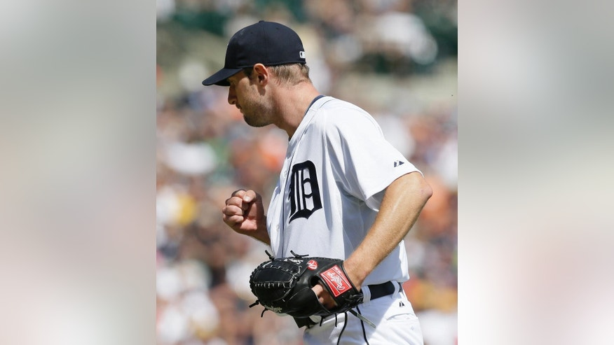 Detroit Tigers starting pitcher Max Scherzer reacts after the last out during the eighth inning of an interleague baseball game against the Pittsburgh Pirates, Thursday, Aug. 14, 2014 in Detroit. Scherzer had 14 strikeouts for the day. (AP Photo/Carlos Osorio)