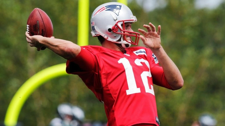 New England Patriots quarterback Tom Brady throws during an NFL Football training camp scrimmage of the Patriots and Philadelphia Eagles in Foxborough, Mass., Tuesday, Aug. 12, 2014. (AP Photo/Charles Krupa)