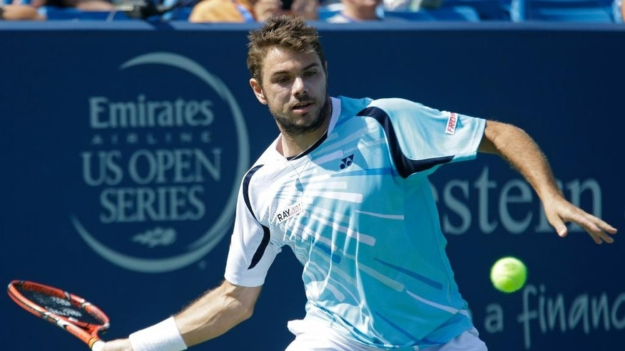 Stan Wawrinka, from Switzerland, eyes a forehand against Julien Benneteau, from France, during a match at the Western & Southern Open tennis tournament, Friday, Aug. 15, 2014, in Mason, Ohio. (AP Photo/Al Behrman)