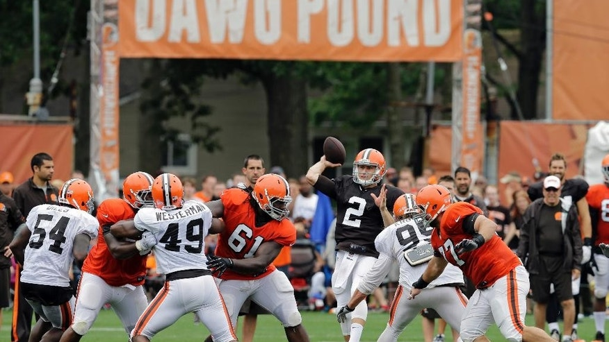 Cleveland Browns quarterback Johnny Manziel (2) passes during practice at NFL football training camp in Berea, Ohio on Monday, Aug. 11, 2014. (AP Photo/Mark Duncan)
